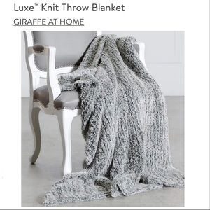 New Giraffe at Home luxe knit throw blanket plush